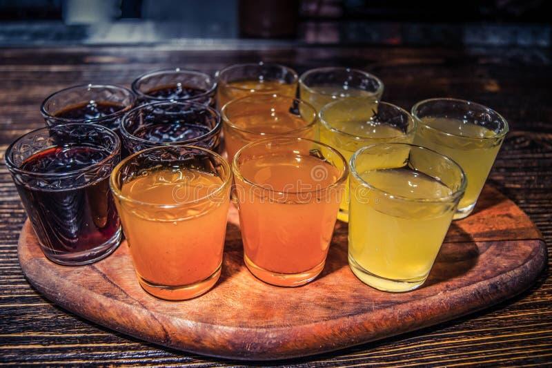 Os tiros bebem a cereja alaranjada do limão fotografia de stock royalty free