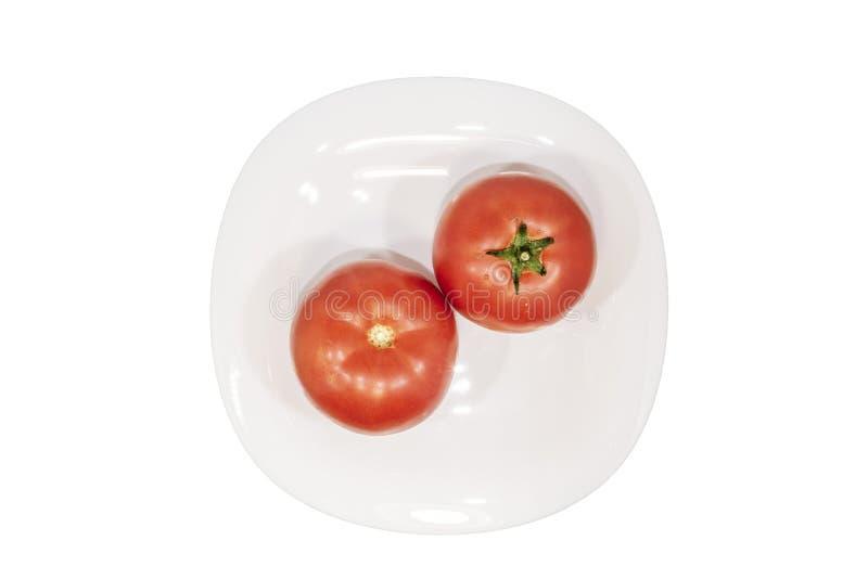 Os tomates frescos no branco plat Vista superior Trajeto de grampeamento imagens de stock royalty free