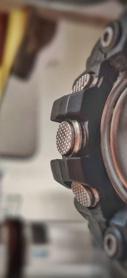 Os três botões mettalic de um lado do relógio tipo do papel de parede foto de stock royalty free