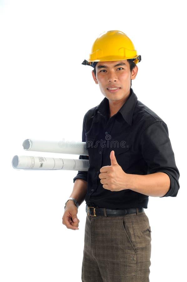 Os trabalhadores felizes mostram o bom símbolo fotos de stock