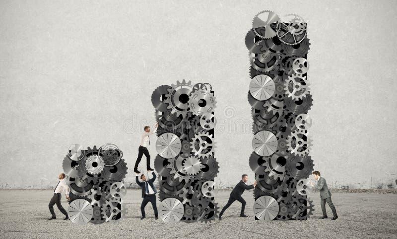 Os trabalhos de equipa constroem o lucro incorporado imagem de stock