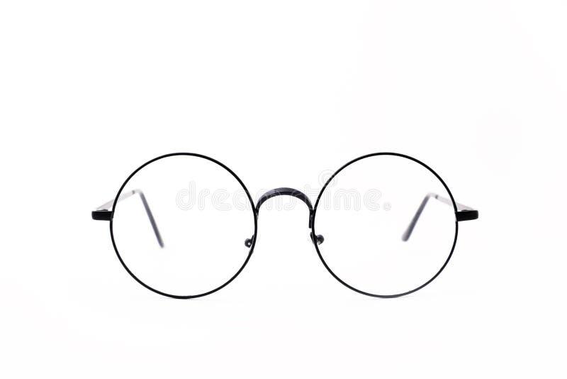 Os vidros preto-orlarados redondos s?o ficados situados frontal em um fundo branco imagem de stock