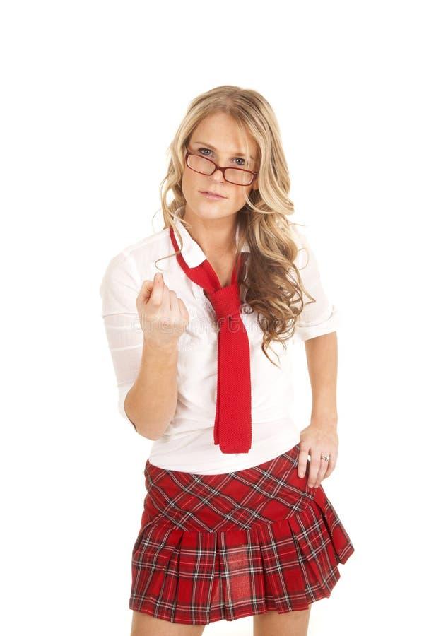 Os vidros vermelhos da menina da escola vêm aqui imagens de stock royalty free