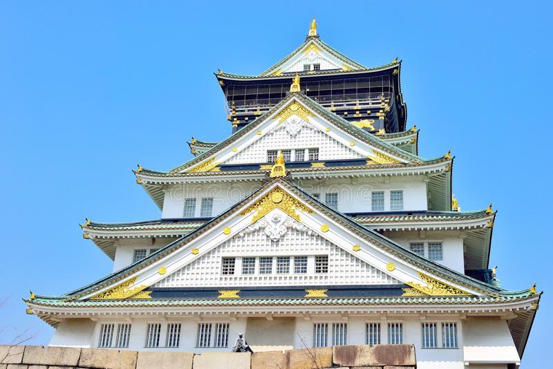 Osaka castle tower closeup with blue sky. Japan royalty free stock photo