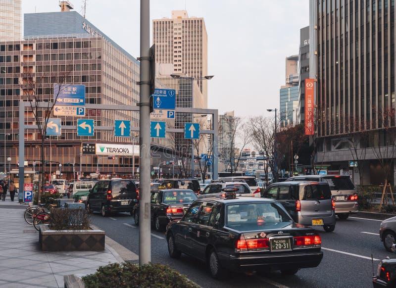 OSAKA, JAPÃO - FEVEREIRO 1,2014: Osaka City Traffic e Transportatio foto de stock royalty free