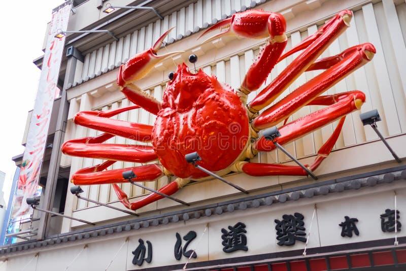 OSAKA, JAPÓN - SEPTIEMBRE, 1: cartelera borrosa i del restaurante del cangrejo imagen de archivo
