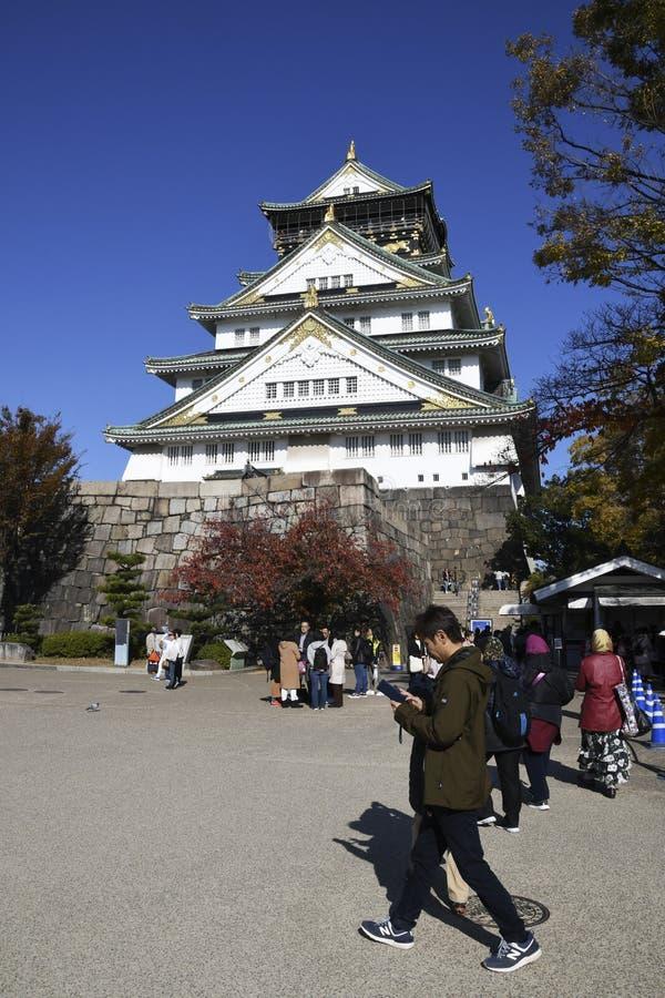 Tourist and people visit the Osaka castle in Osaka, Japan stock photography
