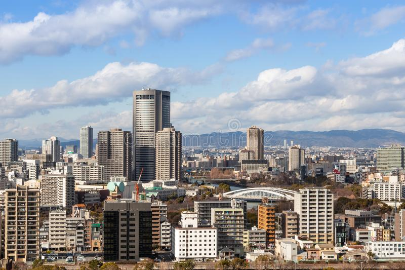 OSAKA , JAPAN - February 1, 2019 : Osaka city scape at daytime . Taken a photo from view point on highest of osaka castle . Obviously seen OAP towers Highest royalty free stock photos
