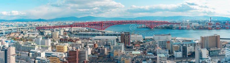 Panoramic aerial view of Osaka bay area with Minato bridge in Osaka, Japan.  royalty free stock photo