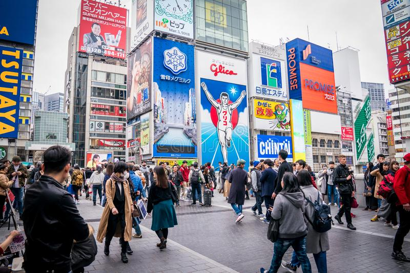 Osaka, Japan - 3 Mar 2018: The Gulico man digital signage billboard is the popular landmark / tourist attraction in the noon at. Namba district, Osaka, Japan stock photos