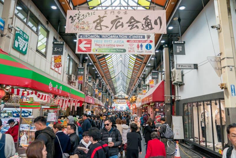 Osaka, Japan - 3 Mar 2018; Japanese local people, tourists and travelers walking and eating at Kuromon Ichiba Market fish market royalty free stock photo