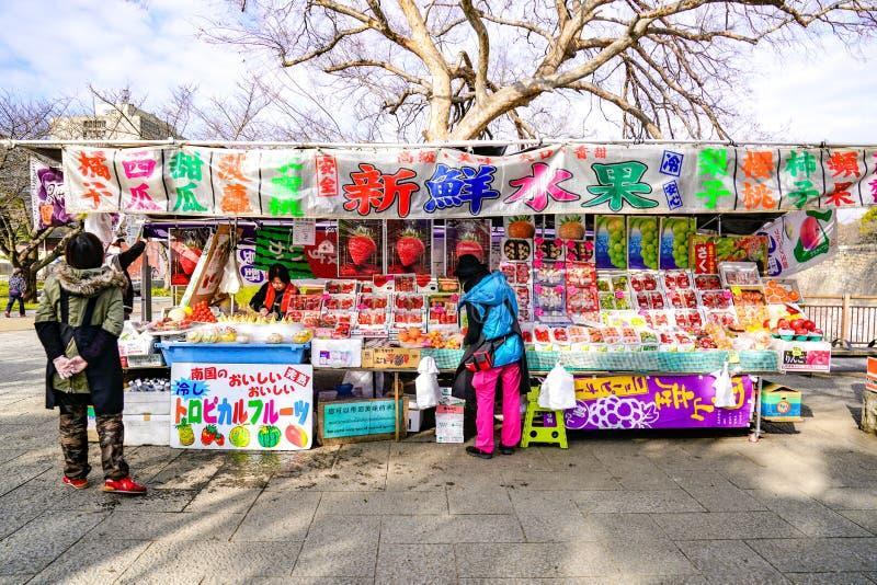 Osaka, Japan - 4 Mar 2018: Local Japan fruits kiosk opened to sell fruits; strawberry, apple, orange, melon, etc. at the Osaka royalty free stock images