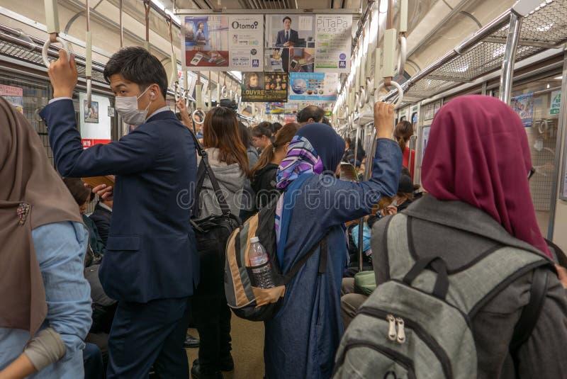 OSAKA, JAPAN 9. NOVEMBER 2018: Eine Gruppe des moslemischen touristischen Inneres lizenzfreie stockbilder
