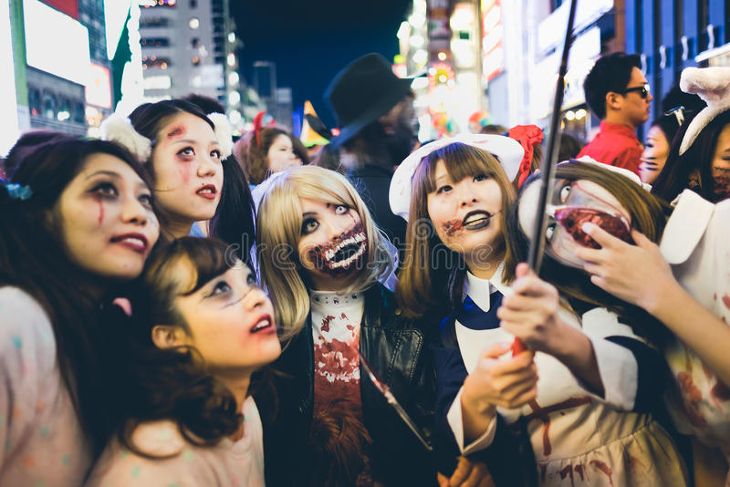 OSAKA,JAPAN - OCTOBER 31 2015 : Dotonbori shopping street in Osaka crowded with people wearing Halloween costumes and makeup, on stock image