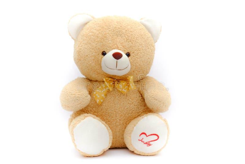 Osamotniona brown niedźwiedzia lala na odosobnionym tle obraz royalty free