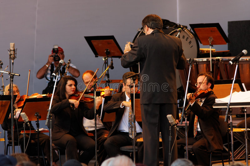 Osasco Orchestra in Campos do Jordao Brazil. Detail of the regent of Osasco Orchestra and the violins in the Winter Festival in Campos do Jordao, Sao Paulo royalty free stock photos