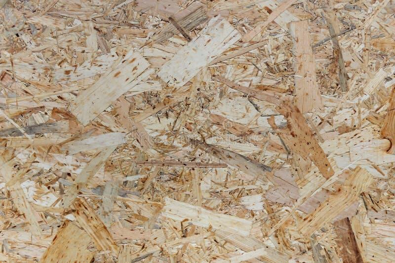 OSB-bräden göras av trächiper Fanérbakgrund för bästa sikt OSB royaltyfria bilder
