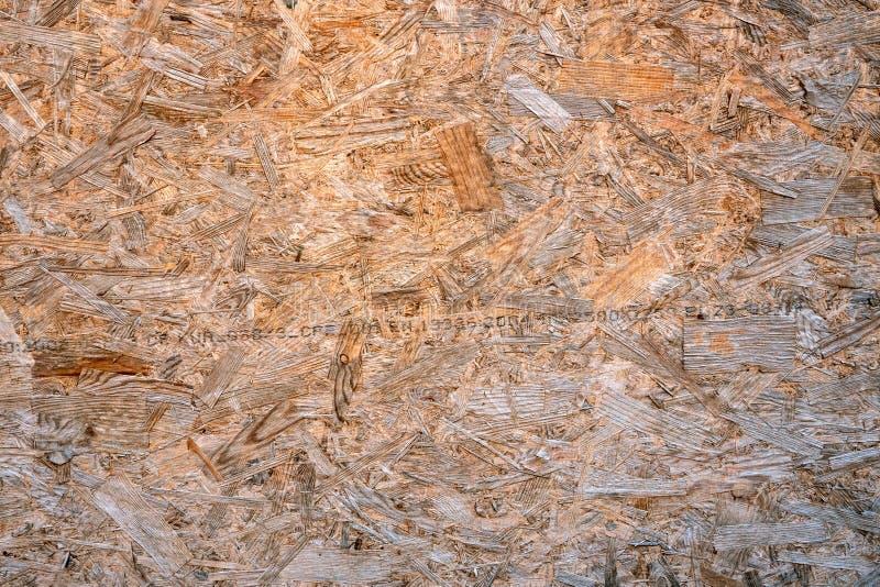 OSB desek ściśnięty trociny lub chipboard Abstrakcjonistyczny tekstury tło kompresował trociny lub naciskał drewnianego panelu zdjęcie royalty free
