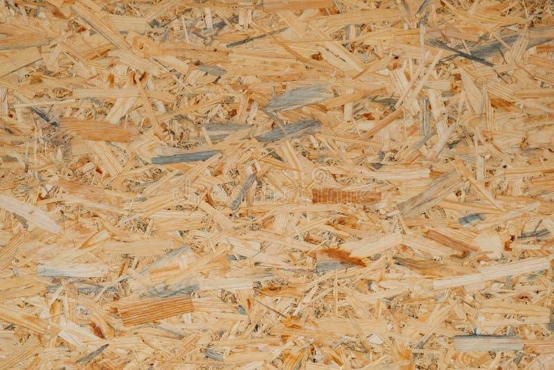 OSB naciskająca trociny deska, drewniani układy scaleni, drewniany tekstury beckground, bezszwowa powierzchnia zdjęcie stock