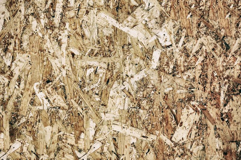 Osb neutral. OSB boards are made of brown wood chips. Top view on the OSB, dense, seamless surfaces stock image