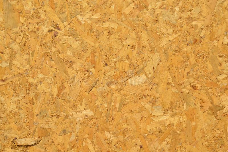 OSB plate consisting of pressed pine tree chips. Background can be stock images