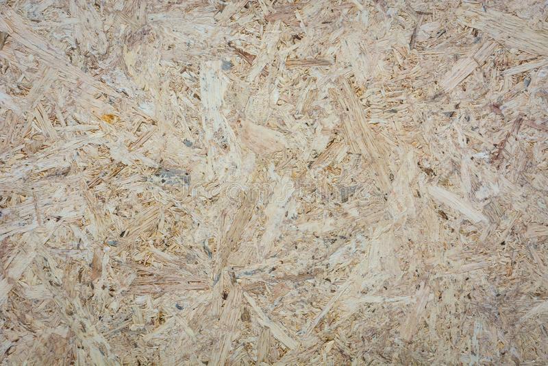 OSB plywood board texture, pressed wooden panel background stock photography