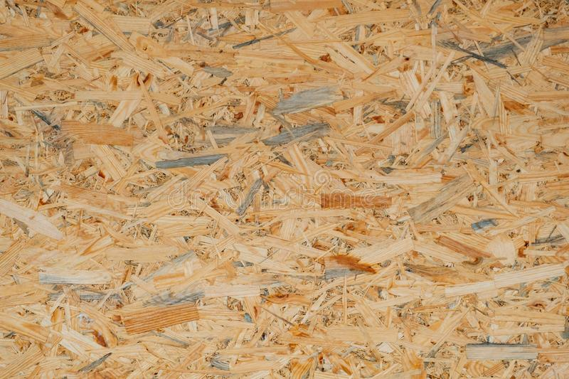OSB pressed sawdust board,wood chips,wooden texture beckground,seamless surface. OSB pressed sawdust board made from wood chips, wooden texture and beckground stock photo