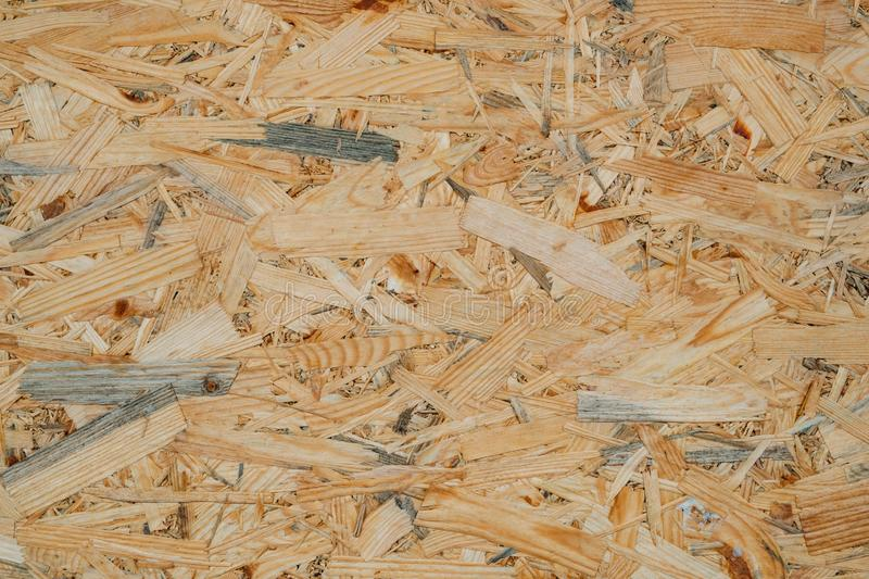 OSB pressed sawdust board,wood chips,wooden texture beckground,seamless surface. OSB pressed sawdust board made from wood chips, wooden texture and beckground royalty free stock images