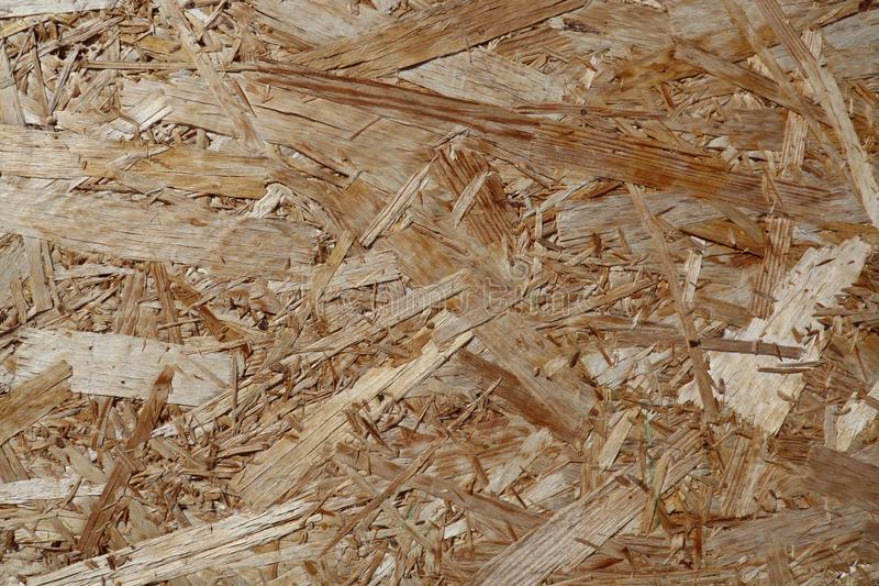 OSB sheet is made of wood chips pressed together. Photo royalty free stock photos