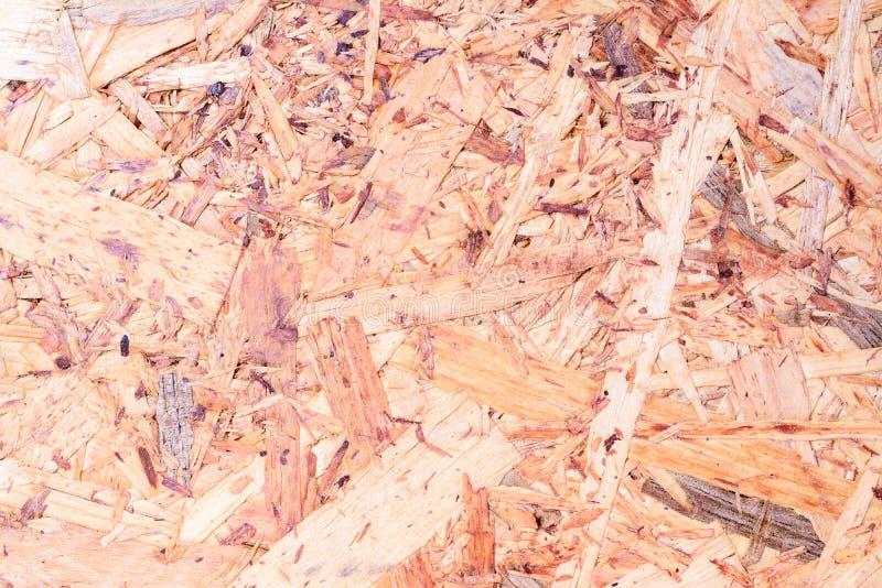 OSB wsiadają teksturę i tło robić brązów magenta drewniani układy scaleni sanded w drewnianego chipboard, Zamyka w górę widoku z  obraz royalty free