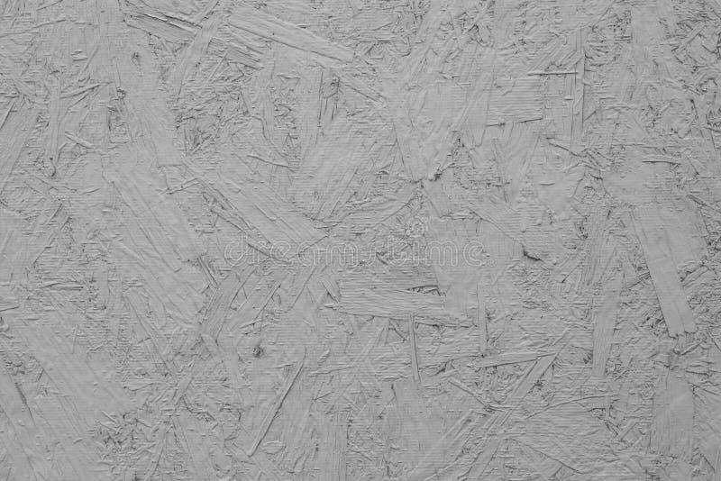 Osbplaat met lichte verf, achtergrondtextuurstructuur wordt behandeld die Gedrukte houten oppervlakte, bouwmateriaal royalty-vrije stock foto