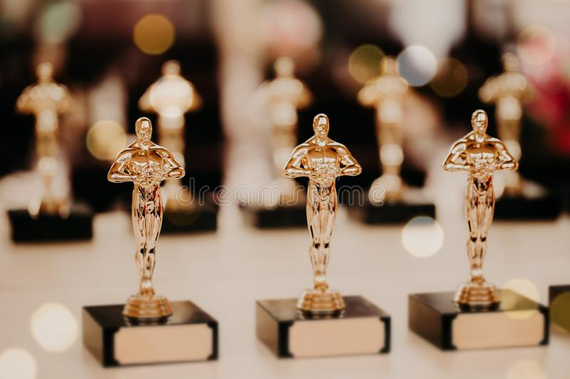 Oscar award. Prize for victory. Golden trophy,. Success concept. Horizontal shot. Prize in film production royalty free stock photography
