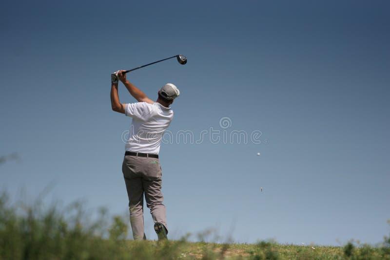 Oscillation de golf d'hommes photographie stock