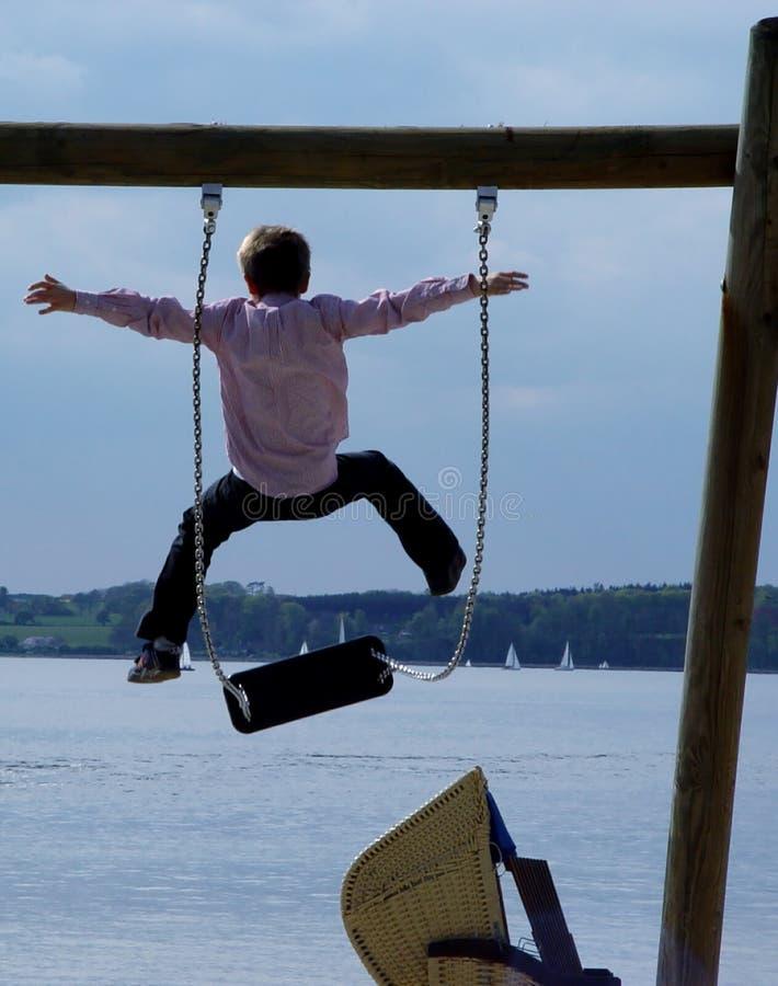 oscillazione + salto fotografie stock