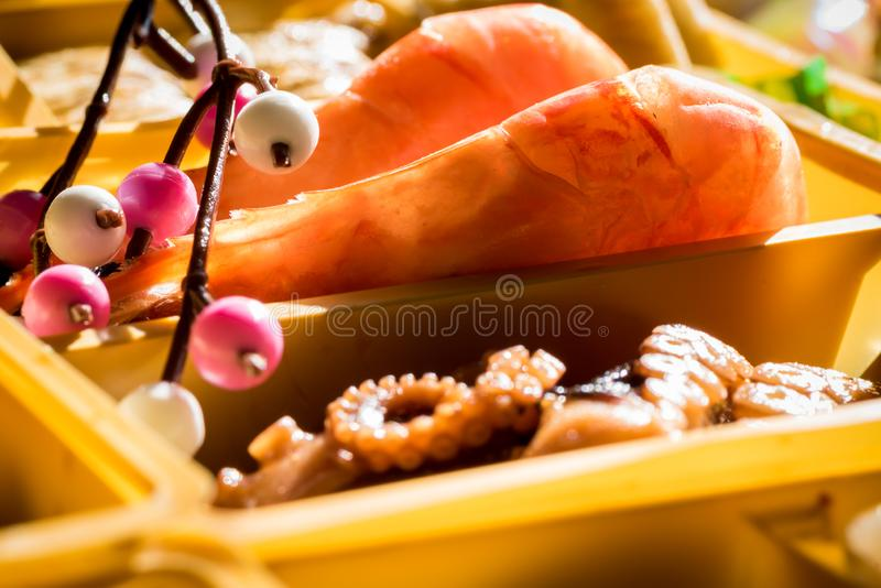 Osechi Ryori are traditional dishes enjoyed by Japanese people on New Year`s day. Osechi are easily recognizable by their special boxes called jubako royalty free stock photo
