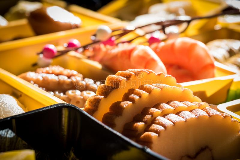 Osechi Ryori are traditional dishes enjoyed by Japanese people on New Year`s day. Osechi are easily recognizable by their special boxes called jubako stock photos