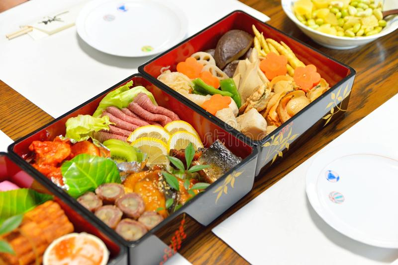 Osechi, traditional Japanese New Year food, in black lacqueware boxes stock photos