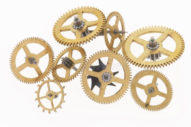 osiem cogwheels złoty stary obraz stock