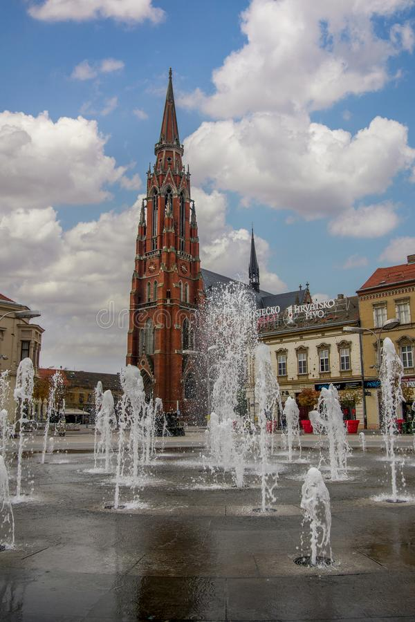 Osijek, Croatia - Nov 3, 2018: Scenic view of fountain on the ma. In square and catholic St Peter and Paul Cathedral in the background stock photo
