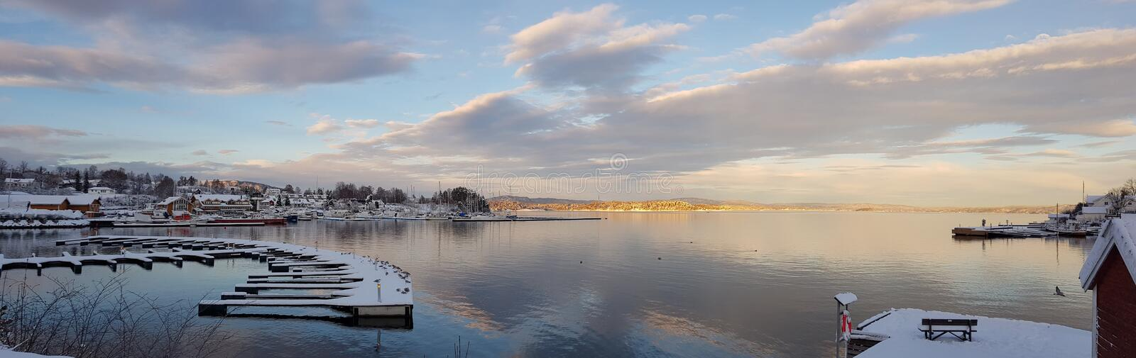 Oslo harbour in the early autumn morning. Oslo harbour, early morning in the autumn, still waters, crisp air, beautiful skies stock images