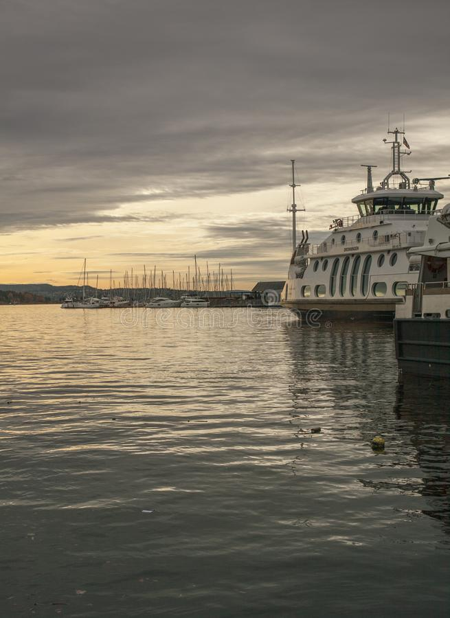 Oslo, Norway - boats and ferries in the port at sunset. royalty free stock photo