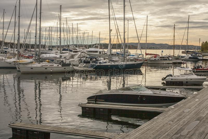 Oslo, Norway, Europe - small boats in the marina - sunset. This images shows some small boats anchored in the marina in Oslo, Norway, Europe. It was taken in royalty free stock photography