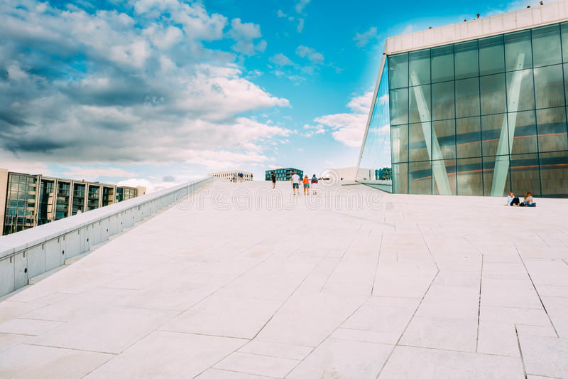 Oslo Norway. Groups Of People Going Up On Slope Of Angled Roof O royalty free stock images