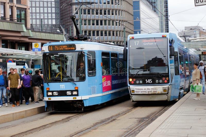 Trams at stop stock photos