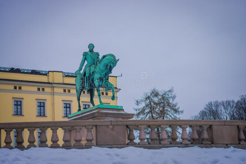 OSLO, NORWAY - MARCH, 26, 2018: Outdoor view of Statue of King Karl Johan outside The Royal Palace in Oslo stock photography