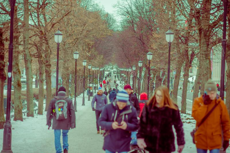 OSLO, NORWAY - MARCH 8, 2017: Unidentified people walking at vigeland Park on a breezy winter day royalty free stock photo