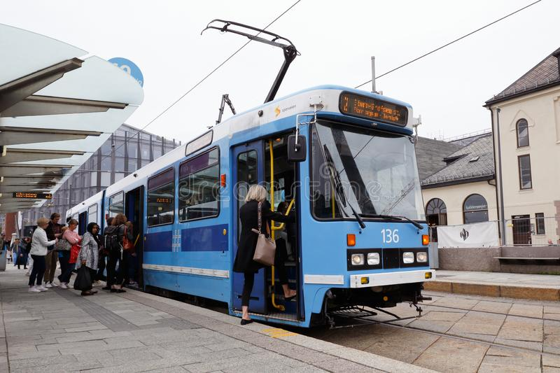 Oslo tram class SL79. Oslo, Norway - June 20, 2019: Passengers at stop Akersbrygge boarding the articulated tram number 136, class SL79, serie II in service on stock images