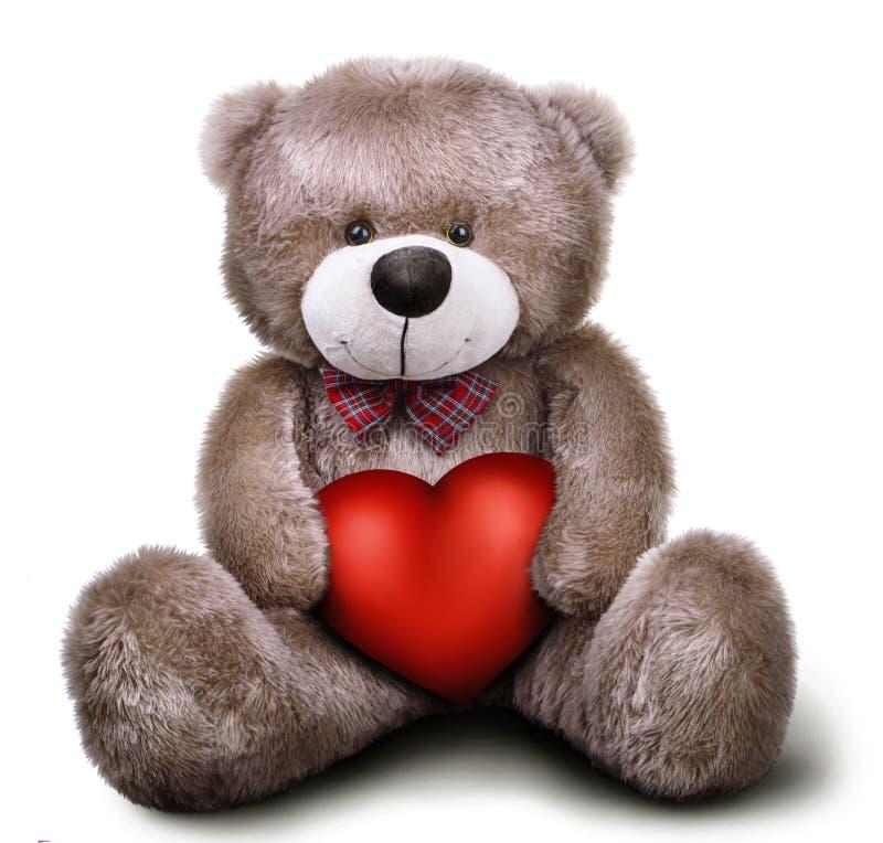 Oso de peluche suave del juguete con el corazón de la tarjeta del día de San Valentín imagen de archivo