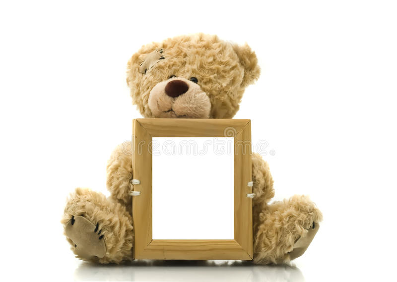 Oso lindo que lleva a cabo el marco vacío para el cuadro o la foto fotografía de archivo