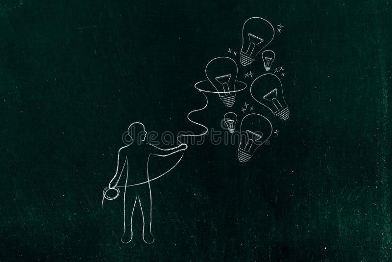Osob zbieraccy lightbulbs z lasso, twórczość co (pomysły) zdjęcie royalty free